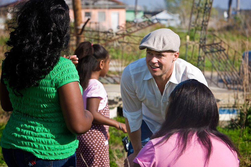 Actor Brad Pitt spends an afternoon with several residents of the Lower 9th Ward discussing the loss of their homes and the devastation of complete neighborhoods by Hurricane Katrina in New Orleans, Louisiana. Frustrated by the slow pace of rebuilding in the Lower Ninth, Brad Pitt set up a foundation called Make It Right to rebuild 150 affordable green homes for returning Lower Ninth residents.