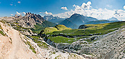 """The peaks of Cadini Group, Sorapiss Group, and Monte Cristallo rise (left to right) in the Dolomites, Veneto region, Italy, Europe. In the Cadini di Misurina, Cima Grande rises to 2999 meters (9839 feet), between Cima Piccola and Cima Ovest. Sorapiss and Monte Cristallo are in the Ampezzo Dolomites. The Cadini Group is in the Sesto Dolomites (Dolomiti di Sesto, or Sexten/Sextner/Sextener Dolomiten) which lie north of the Fiume Ansiei valley and Auronzo. From the Rifugio Auronzo toll road, hike for spectacular views around Tre Cime di Lavaredo (Italian for """"Three Peaks of Lavaredo,"""" called Drei Zinnen or """"Three Merlons"""" in German). The Dolomites are part of the Southern Limestone Alps. UNESCO honored the Dolomites as a natural World Heritage Site in 2009. Panorama stitched from 8 overlapping photos."""