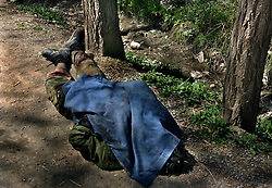 SRINAGAR, KASHMIR,INDIA, MARCH 21, 2004: The body of an alleged foreign separatist militant who holed himself up inside a Kashmiri home lies in Narkara, some 12 miles southwest of Srinagar, India,  March 21, 2004. One suspected militant and a soldier were killed in the gunbattle that lasted 12 hours. (Ami Vitale/Getty Images)