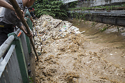 February 5, 2018 - Bogor, West Java, Indonesia - Bogor, West Java, 05 February 2018 : As heavy rain hit most of area in Indonesia, one of the place Bogor that was flowed by Ciliwung River over flowed and hit the area soon also hit Jakarta. Some home and school at the area hit by flood from the river because of stock pile of garbage that halt the flow of the water, it's very common for Indonesia people just throw garbage to the river as the law enforcement for environtment very weak at the country. (Credit Image: © Donal Husni via ZUMA Wire)