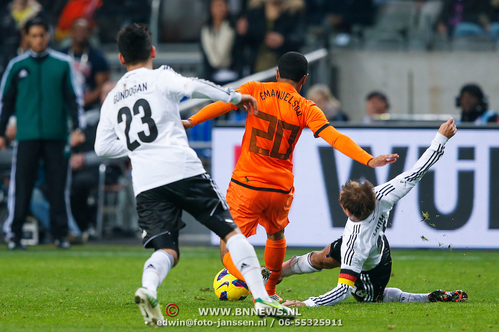 NLD/Amsterdam/20121114 - Vriendschappelijk duel Nederland - Duitsland, Urby Emanuelson in duel met Phillip Lahm en ilkay Gunddogan