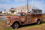 Abandoned rusty fire truck engine at The Shack Up Inn, cotton sharecroppers theme hotel, Clarksdale, Mississippi, USA