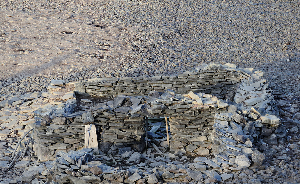 The remains of the stone hut built by Carl Anton Larsen, the Norwegian Antarctic Explorer,  and his men. They  were marooned  for more than nine months in 1903 on Paulet Island. Paulet Island, Antarctic Peninsula. Antarctica. 02Mar16