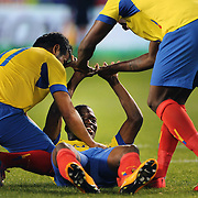 Enner Valencia, Ecuador, is congratulated by team mates after scoring during the Ecuador Vs El Salvador friendly international football match at Red Bull Arena, Harrison, New Jersey. USA. 14th October 2014. Photo Tim Clayton
