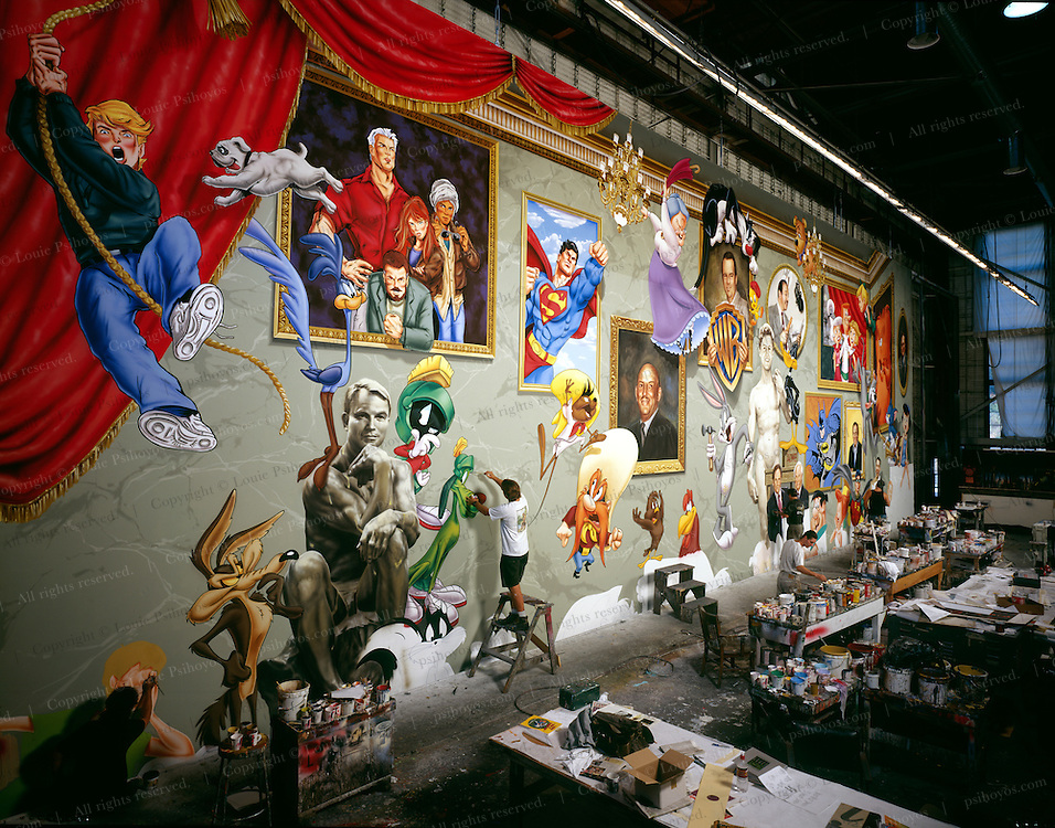Artist make a mural for to celebrate cartooning at the Canne Film Festival.  Paintings of cartoon characters and the famous Warner Brothers directors and creators who invented them.