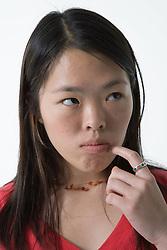 Studio portrait of a teenage girl looking sad,
