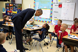 President Barack Obama visits with students in a classroom at Clarence Tinker Elementary School at MacDill Air Force Base in Tampa, Fla., Sept. 17, 2014. (Official White House Photo by Pete Souza)<br /> <br /> This official White House photograph is being made available only for publication by news organizations and/or for personal use printing by the subject(s) of the photograph. The photograph may not be manipulated in any way and may not be used in commercial or political materials, advertisements, emails, products, promotions that in any way suggests approval or endorsement of the President, the First Family, or the White House.