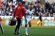 Andre Ayew of Swansea city reacts in pain after taking a knock during play. Barclays Premier league match, Swansea city v Norwich city at the Liberty Stadium in Swansea, South Wales  on Saturday 5th March 2016.<br /> pic by  Andrew Orchard, Andrew Orchard sports photography.