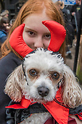 Nala, a Carashon, with Anna - A charity Halloween Dog Walk and Fancy Dress Show organised by All Dogs Matter at the Spaniards Inn, Hampstead. London 29 Oct 2017.