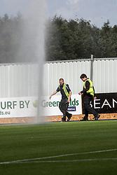 Watering the plastic pitch.<br /> Falkirk 3 v 1 Morton, Scottish Championship 17/8/2013.<br /> ©Michael Schofield.