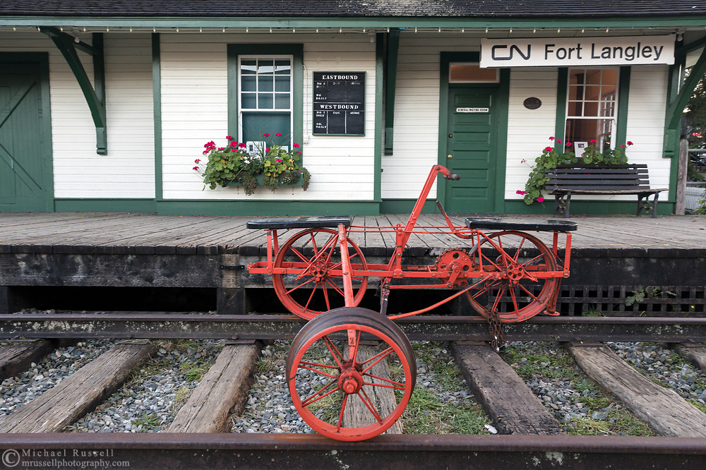 A Velocipede (handcar) from 1887 sits on the tracks outside the historic CN Station in Fort Langley, British Columbia, Canada.  The CN Station was built in 1915 and is now owned by the Township of Langley. Operations and maintenance of the station is by the Langley Heritage Society.