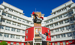 South Africa - Cape Town - 7 July 2020 - Zip Zap performers Jacobus Classen(in air) and Jason Barnard execute a circus move in front of the entrance of the Red Cross Children's Hospital. THE ZIP ZAP Circus will later this month be paying tribute to Nelson Mandela on his birthday, with a free virtual screening of 'The Caretaker ' to children in paediatric hospitals, shelters and<br />children's homes, locally and abroad. Considering the level 3 lockdown restrictions, the circus institution will pay it forward in a rather novel way on July 18. Picture Courtney Africa/African News Agency(ANA)