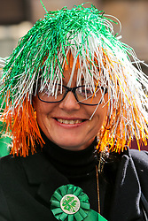 © Licensed to London News Pictures. 17/03/2019. London, UK. A woman celebrate St Patrick's Day as the parade travels through the streets of central London. Photo credit: Dinendra Haria/LNP