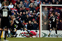 Photo: Jed Wee.<br />Doncaster Rovers v Swansea City. Coca Cola League 1.<br />17/12/2005.<br />Doncaster's Lewis Guy (C) is sent crashing in the box as Swansea concede a penalty.