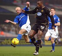 Photo: Daniel Hambury.<br /> The Coca Cola Championship.<br /> Ipswich Town V Wigan Athletic.   21/12/2004<br /> Ipswich's Matt Richards battles with Wigan's Jason Roberts