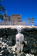 Wooden tikis in front of the Hale-o-Keawe Heiau (temple) at Pu'uhonua o Honaunau National Historic Park (City of Refuge), Kona Coast, The Big Island, Hawaii