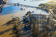 Nederland, Overijssel, Deventer, 20-01-2011. Zicht op Deventer met in de voorgrond het buitendijks aan de IJssel gelegen park De Worp. Boven in beeld de Wilhelminabrug..Het Worpplantsoen is onderdeel van de stadswijk De Hoven. Het in het park gelegen IJsselhotel is door het hoogwater alleen nog per boot te bereiken...View on the flooded park De Worp. The hotel (IJsselhotel) in the park can only be reached by boat, due to the high waters of the river IJssel..luchtfoto (toeslag), aerial photo (additional fee required).copyright foto/photo Siebe Swart