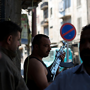 August 14, 2012 - Aleppo, Syria: A group of Free Syria Army (FSA) fighters take guard at a rebel checkpoint in Babal Nassar neighborhood in Aleppo's old city. The Syrian Army have in the past ten days increased their attacks on residential neighborhoods where Free Syria Army rebel fights have their positions in Syria's commercial capital, Aleppo. (Paulo Nunes dos Santos/Polaris)