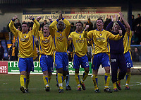 Photo. Glyn Thomas.<br /> Mansfield Town v Hull City.<br /> Nationwide League Division 3.<br /> Field Mill, Mansfield. 06/03/2004.<br /> Mansfield Town players salute the crowd after their 1-0 win.