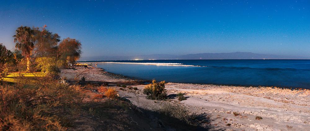 The Salton Sea is captured on a moonlit night.