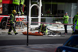 © Licensed to London News Pictures. 10/08/2017. London, UK. The scene on Lavender Hill where a bus crashed into a shop during the morning rush hour. Emergency services are attending. Some casualties have been reported. Photo credit: Ben Cawthra/LNP