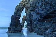 Dusk over the cliff with arches, Galicia, Spain<br /> <br /> Abenddämmerung über der Steilklippe mit Felsbögen, Galizien, Spanien