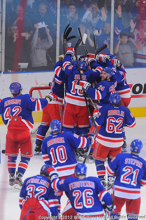 May 12, 2012: The New York Rangers mob goalie Henrik Lundqvist (30) in celebration of their victory in game 7 of the NHL Eastern Conference Semi-finals between the Washington Capitals and New York Rangers at Madison Square Garden in New York, N.Y. The Rangers defeated the Capitals 2-1.