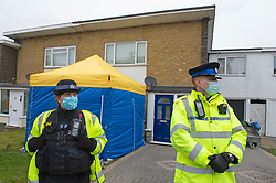 © Licensed to London News Pictures 10/03/2021. Deal, UK. Police stand guard outside a terrace house in Deal, Kent. A police officer has been arrested a property is currently being search in connection with missing Sarah Everard, who was last seen in Clapham, London. Photo credit:Grant Falvey/LNP
