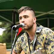 Kew The Music 2019 - a musician performs at the food village on 9 July 2019, Kew Garden, London, UK.