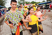 Oct. 3, 2009 - CHONBURI, THAILAND: High school students perform traditional Thai dance in the parade during the first day of races at the Chonburi Buffalo Races Festival, Saturday, Oct. 3. Contestants race water buffalo about 200 meters down a muddy straight away. The buffalo races in Chonburi first took place in 1912 for Thai King Rama VI. Now the races have evolved into a festival that marks the end of Buddhist Lent and is held on the first full moon of the 11th lunar month (either October or November). Thousands of people come to Chonburi, about 90 minutes from Bangkok, for the races and carnival midway. Photo by Jack Kurtz / ZUMA Press