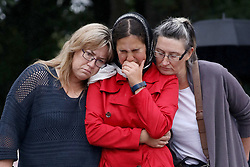 March 18, 2019 - Christchurch, New Zealand - Residents pay their respects outside the Al Noor mosque in Christchurch, New Zealand on March 17, 2019. At least 50 people were killed and 36 injured in mass shootings at two mosques in the New Zealand city of Christchurch Friday, 15 March. A 28-year-old Australian born man appeared in Christchurch District Court on Saturday charged with murder. (Credit Image: © Sanka Vidanagama/NurPhoto via ZUMA Press)