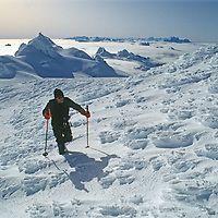 Mountaineer Jack Miller ascends an unnamed peak in the little-known Cordillera Sarmiento of Patagonia, near the tip of of South America.  Hielo Sur, earth's largest non-polar icecap is shrouded by fog in the background and the mountains here are plastered with icy rime ice borne by winds that commonly exceed 100mph.
