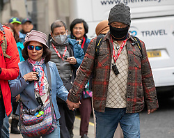 © Licensed to London News Pictures. 31/01/2020. London, UK. A couple with protective masks on walk in Westminster this morning as two English patients are confirmed to have the Coronavirus in the UK. Photo credit: Alex Lentati/LNP