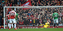 Brighton & Hove Albion goalkeeper Mathew Ryan is beaten by Arsenal's Pierre-Emerick Aubameyang (hidden) for the first goal from the penalty spot