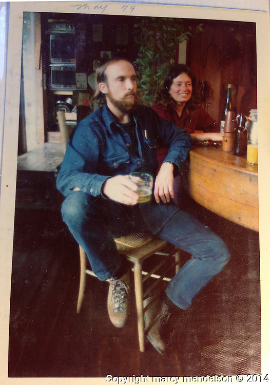 This picture was taken 40 years ago, and today Ed & Marilyn Stiles still entertain guests around the kitchen table he build in the early days of Druid Heights.  This photographer drank coffee and interviewed the couple as Ed sat in the same chair, with Marilyn laughing and adding details to the stories.