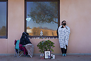 Family of Jose Garcia, 67, who is currently being treated for COVID-19 on a ventilator, wait by his hospital window during a surge of coronavirus disease (COVID-19) cases at Memorial Medical Center in Las Cruces, New Mexico, U.S. November 29, 2020.  REUTERS/Paul Ratje