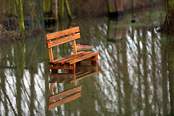 04 February 2021. Beaumarie Saint Martin, Pas de Calais, France.<br /> A park bench is inundated following record flooding from the Canche river in Beaumarie Saint Martin in Pas de Calais in north western France.<br /> Photo©; Charlie Varley/varleypix.com<br /> All rights managed.