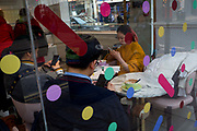 Rather than holding a conversation between themselves, three customers all use their phones inside a Soho cafe on Old Brompton Street, on 5th March 2018, in London, England.