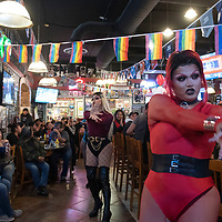 Tomahawk Martini, right, and Nova Gina Martini, center, perform as part of the drag troupe Blackout at Diné Pride's Queen of Hearts Dance and Drag Show Saturday night at Sammy C's Rock N' Sports Pub & Grille in Gallup. All proceeds from the event benefit the Diné Pride Youth Scholarship.