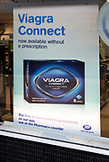 Boots chemist shop window Viagra Connect advertising poster, Calne, Wiltshire, England, UK