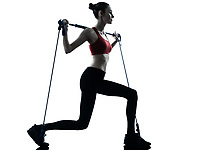 one caucasian woman exercising elastic gymstick in silhouette studio isolated on white background