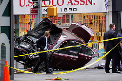May 18, 2017 - New York, New York, U.S. - Police officers and emergency workers investigate the scene of a car crash in Times Square that took the life of an 18 year-old Michigan girl and injured 22 others. (Credit Image: © Kevin C. Downs/ZUMA Wire/ZUMAPRESS.com)