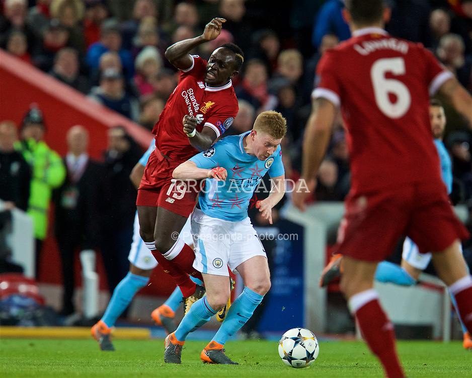 LIVERPOOL, ENGLAND - Wednesday, April 4, 2018: Liverpool's Sadio Mane is fouled by Manchester City's (right) Kevin De Bruyne during the UEFA Champions League Quarter-Final 1st Leg match between Liverpool FC and Manchester City FC at Anfield. (Pic by David Rawcliffe/Propaganda)