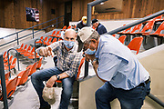 """22 SEPTEMBER 2020 - DUNLAP, IOWA: Congressional candidate J.D. SCHOLTEN (left) talks to JAY SCHABEN, a co-owner of Dunlap Livestock Auction, about farm policy. Scholten, a Democrat from Sioux City, Iowa, ran against incumbent CongressmanSteve King (R-4th District Iowa) in 2018 and came within a few percentage points of upsetting the long serving conservative. King lost to Randy Feenstra, a Republican challenger, in the 2020 primary and Scholten is running against Feenstra in the 2020 general election on November 3. Iowa's 4th district, centered in the agricultural and sparsely populated northwest corner of the state, is the largest congressional district in Iowa and encompasses about ⅓ of the state of Iowa. Scholten is on his """"Every Town Tour 2020."""" He is visiting all 375 towns in the 39 counties in the district.     PHOTO BY JACK KURTZ"""