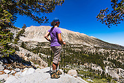 Hiker enjoying the view in the Big Pine Lakes basin, John Muir Wilderness, California USA