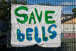 London, UK. 14th August, 2021. A banner prepared by local residents and campaigners is displayed on fencing around sports facilities at Bells Gardens in Peckham. Southwark Council proposes to build 97 new homes (a mix of social and private housing), a reprovisioned community facility and a multi-use games area at Bells Gardens, a well-used community park serving the 545-home Bells Gardens estate. Southwark ranks fifth-worst in London and eighth-worst in the UK for easy access to green space.