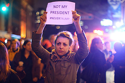 © Licensed to London News Pictures. 09/11/2016. New York, USA. Thousands of anti-Trump protesters march from Union Square to Trump Tower in New York City, on Wednesday, 9 November 2016 following the presidential election won by Donald Trump. Photo credit: Tolga Akmen/LNP