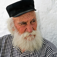 Naxos. Cyclades. Greece. Portrait of an old white bearded man at the marble mountain village of Apirathos. One of islands oldest settlements and entirely built of marble,