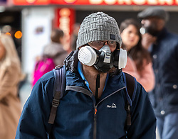 March 16, 2020, London, UK: A London commuter on his way to work in an unusual mask at a quiet Victoria Station this morning as Government ministers warn that over 70s will face self-isolation for weeks as the Coronavirus disease pandemic continues. (Credit Image: © Alex Lentati/London News Pictures via ZUMA Wire)