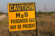 Warning sign at a  fracking site in Big Spring Texas, part of the  Permian Basin.